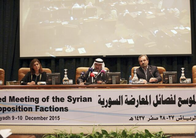 In this Thursday, Dec, 10, 2015 photo Abdulaziz bin Saqr, center, Chairman of the Gulf Research Council, speaks as Louay Safi, right, spokesperson for the Syrian National Coalition, and Hind Kabawat, left, a member of the elected committee that will negotiate with the Syrian regime, listen during a press conference after a three-day meeting of Syrian opposition groups in Riyadh, Saudi Arabia