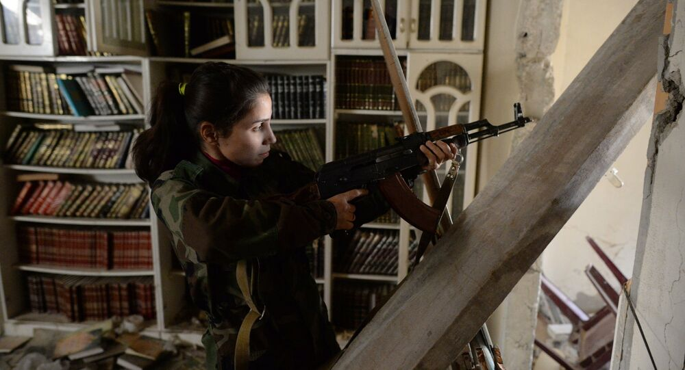 A female sniper from a special weapons and tactics (SWAT) regiment of the Syrian Arab Army in Darayya, a Damascus suburb.