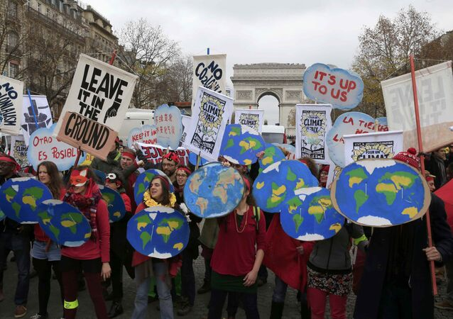 Environmentalists demonstrate near the Arc de Triomphe in Paris, France, as the World Climate Change Conference 2015 (COP21) continues at Le Bourget, December 12, 2015