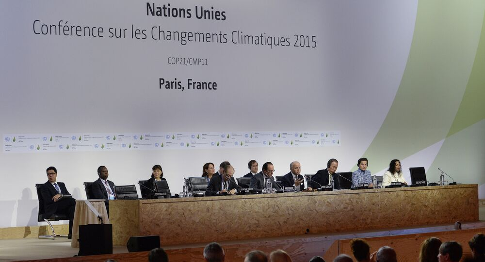 French President Francois Hollande (2ndL), French Foreign Minister Laurent Fabius (C), United Nations Secretary General Ban Ki-moon (3rddR) and UN climate chief Christiana Figueres (2ndR) make a statement at the COP21 Climate Conference in Le Bourget, north of Paris