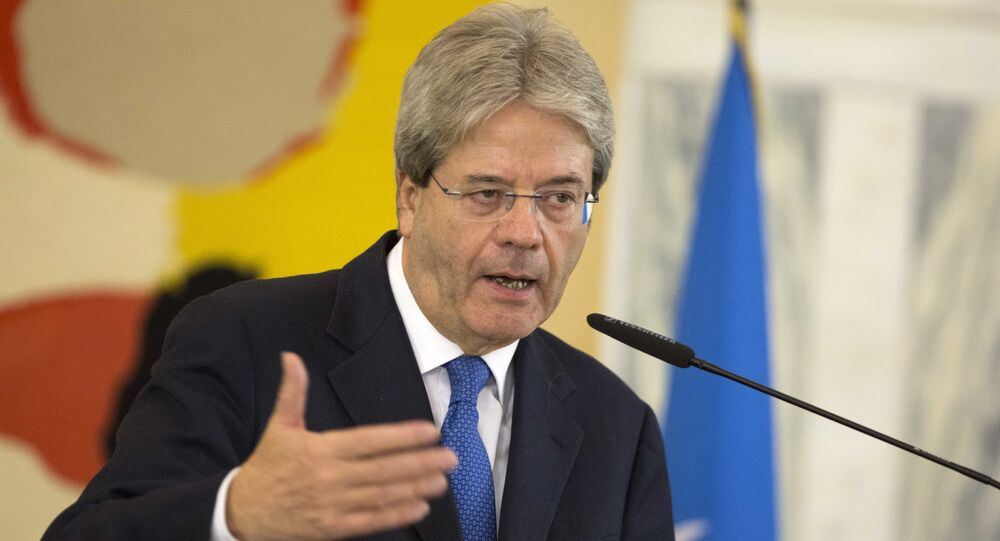 Italian Foreign Minister Paolo Gentiloni speaks during a joint press conference with US Secretary of State John Kerry and Special Representative of the UN Secretary-General for Libya Martin Kobler, at the end of a meeting on Libya at the Italian Foreign Ministry headquarters in Rome, Sunday, Dec. 13, 2015.