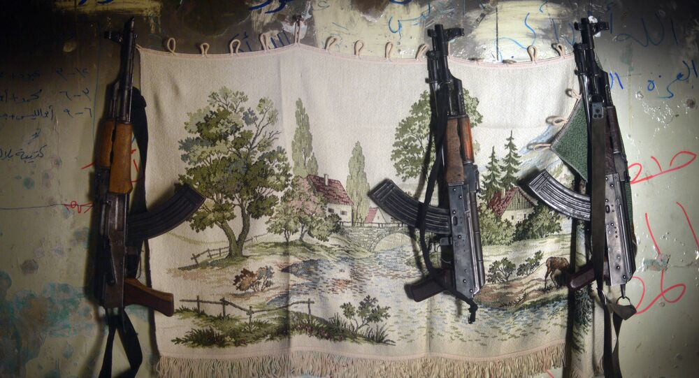AK-47 machine guns hang in a shelter for Syrian rebels in the Salaheddine district of the northern Syrian city of Aleppo