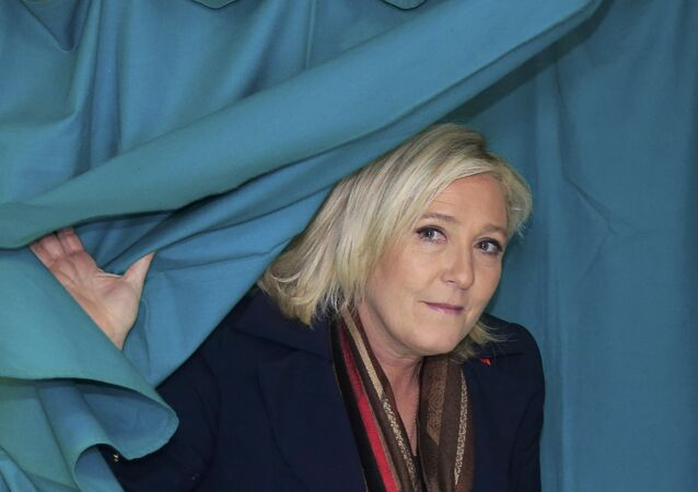 Marine Le Pen, French National Front political party leader and candidate for the National Front in the Nord-Pas-de-Calais-Picardie region, leaves the polling booth to cast her ballot in the second-round regional elections in Henin-Beaumont, France, December 13, 2015.