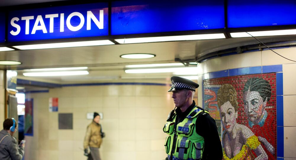 A British police officer stands outside Leytonstone underground train station in east London, Monday, Dec. 7, 2015.