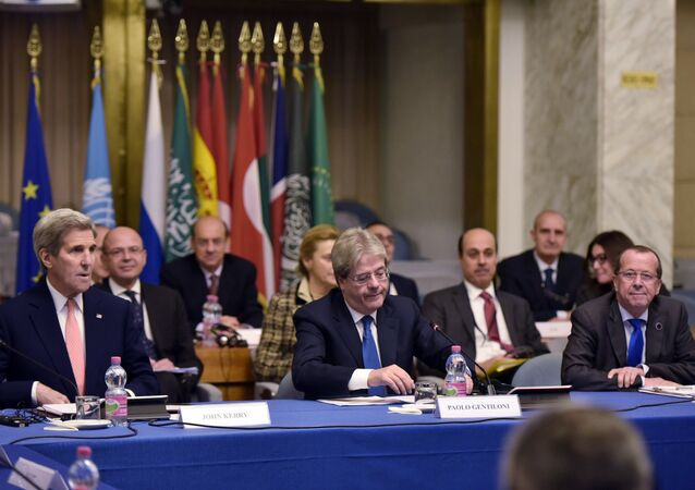 US Secretary of State John Kerry, left, and Italy's Foreign Minister Paolo Gentiloni, center, and UN special envoy for Libya Martin Kobler, right, take part in an international conference on Libya at the Ministry of Foreign Affairs in Rome Sunday, Dec. 13, 2015.