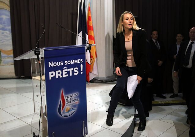Far right National Front party regional leader for southeastern France Marion Marechal-Le Pen arrives to deliver her speech after the second round of the regional elections in Marseille, southern France, Sunday, Dec. 13, 2015.
