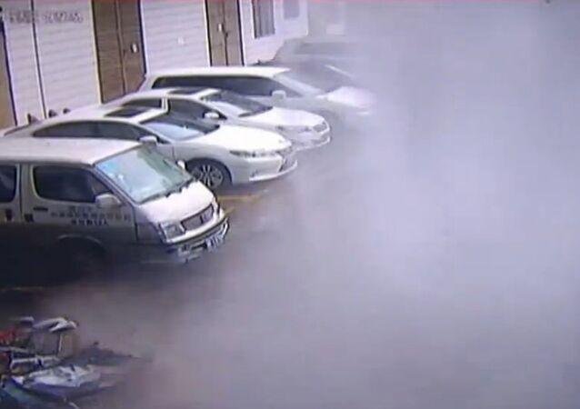 Wall collapses on parking lot in China