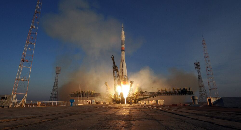 A Soyuz-FG launch vehicle with the Soyuz TMA-19M manned spacecraft lifts off from the Baikonur Space Center