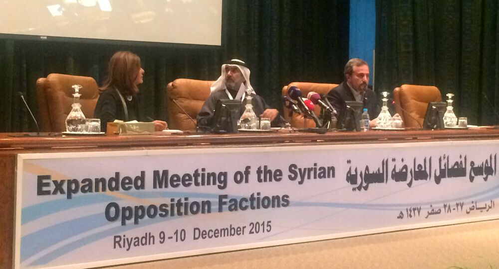 Saudi official Abdulaziz al-Saqr (C) and members of the Syrian opposition Louai Safi (R) and Hend Kapwat (L) talks to media during a press conference held after the end of the Syrian Opposition conference in Riyadh, on December 10, 2015