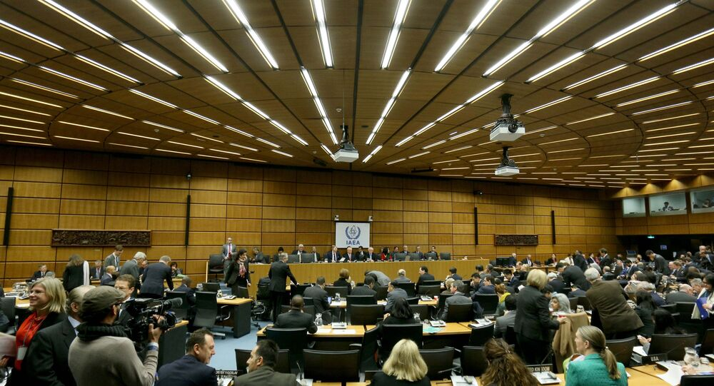 Delegates wait for the start of the board of governors meeting of the International Atomic Energy Agency, IAEA, at the International Center in Vienna, Austria, Tuesday, Dec, 15, 2015.