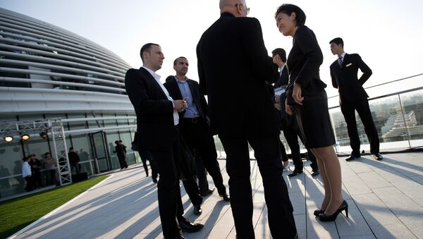 Soho China CEO Zhang Xin, second from right, chats with guests at her newly opened Galaxy Soho building in Beijing Saturday, Oct. 27, 2012. - Sputnik International
