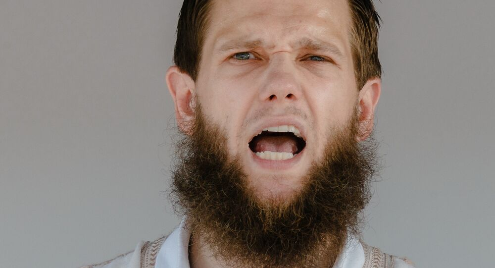 Islamist preacher Sven Lau aka Abu Adam talks during a rally on July 19, 2014 in Hamburg, northern Germany.