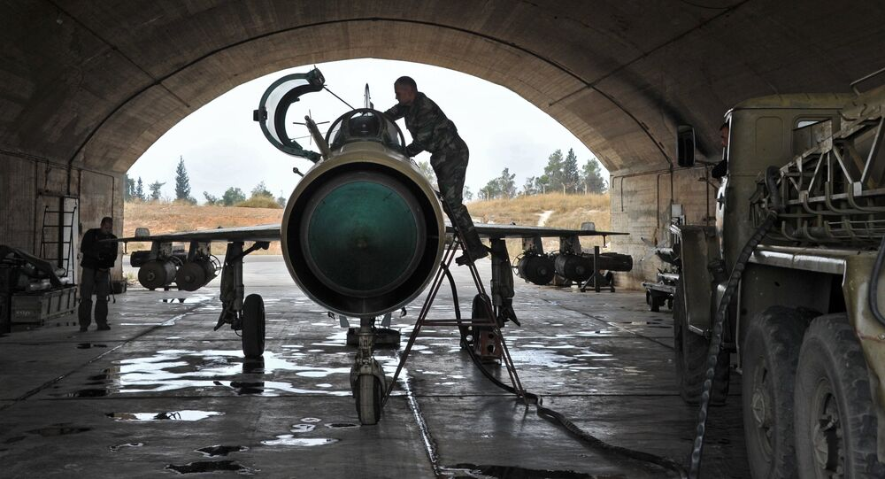 MiG-21 aircraft of the Syrian Air Force gets ready for a mission at the Hama airbase near the city of Hama, Syria's Hama Province