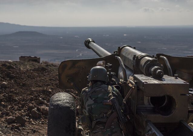 File photo: A soldier of the Syrian Arab Army at an observation post