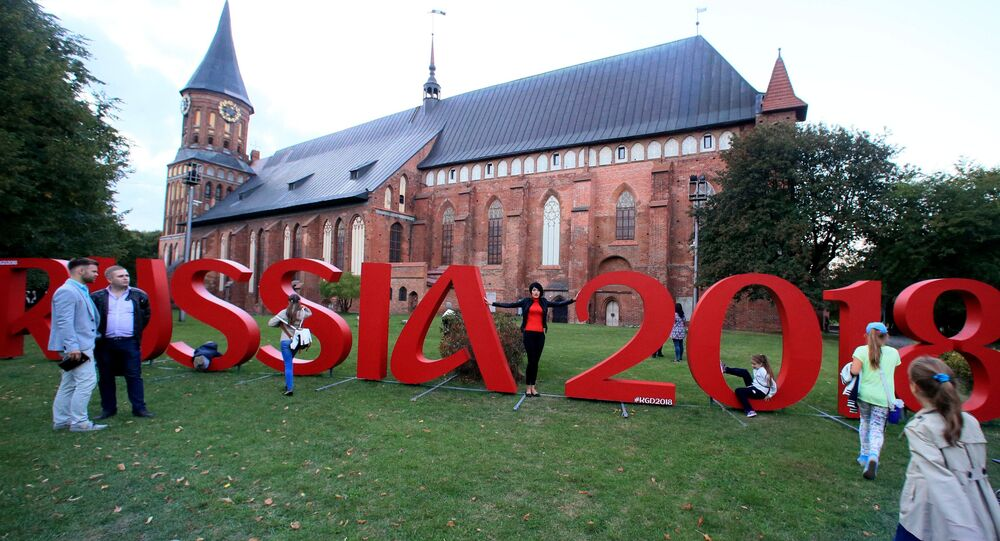 The official hashtag of the 2018 FIFA World Cup, which Russian will host, stands in front of the Konigsberg Cathedral, Kaliningrad