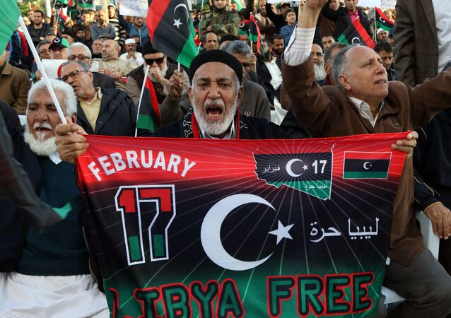 Libyan protesters shout slogans during a demonstration against a UN-sponsored agreement on forming a national unity government, on December 11, 2015 in the capital Tripoli.