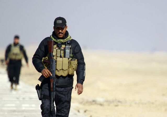 Members of the Iraqi security forces patrol the Najaf governorate's border with the mostly Islamic State (IS) group controlled western province of Anbar as new security measures have been taken to beef up security on the border of the Saudi desert on January 24, 2015