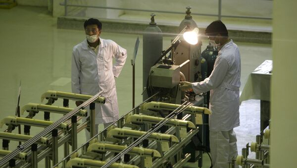 In this April 9, 2009 file picture Iranian technicians work at a new facility producing uranium fuel for a planned heavy-water nuclear reactor, just outside the city of Isfahan, 255 miles (410 kilometers) south of the capital Tehran - Sputnik International