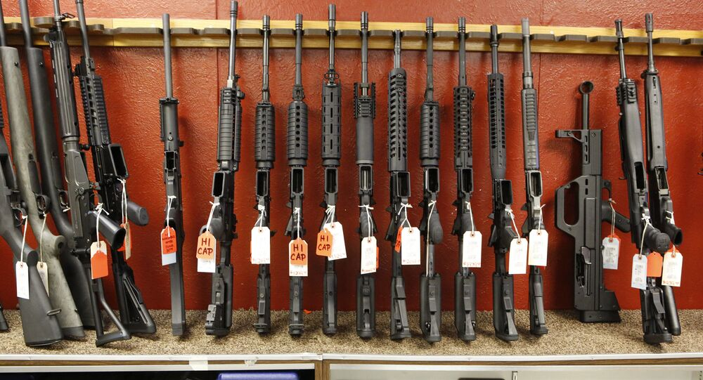 This photo taken on Thursday, June 27, 2013, shows a rack of rifles at Firing-Line gun store in Aurora, Colo.