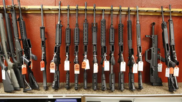 This photo taken on Thursday, June 27, 2013, shows a rack of rifles at Firing-Line gun store in Aurora, Colo. - Sputnik International