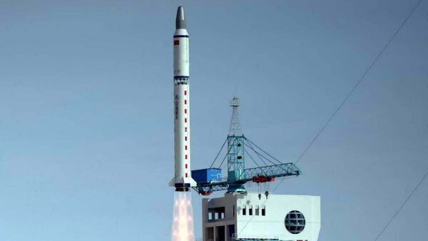 China's Long March 2-D carrier rocket carrying a Chinese-made satellite takes off from the Jiuquan Satellite Launch Center in northwest China's Gansu Province Monday, Nov. 3, 2003 - Sputnik International