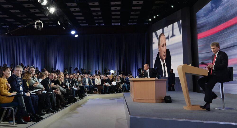 December 17, 2015. Russian President Vladimir Putin at the 11th annual news conference at the World Trade Center on Krasnaya Presnya. Right: Presidential Press Secretary Dmitry Peskov