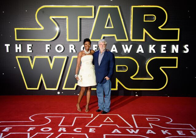 Star Wars creator George Lucas and his wife Mellody Hobson pose for photographers upon arrival at the European premiere of the film 'Star Wars: The Force Awakens ' in London.