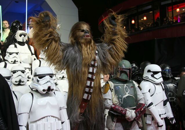 People dressed as characters from the film pose for photographers upon arrival at the European premiere of the film 'Star Wars: The Force Awakens ' in London.