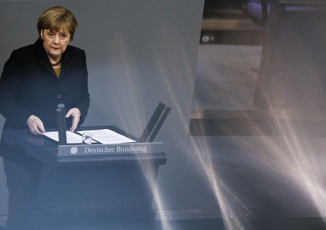 German Chancellor Angela Merkel delivers her speech about the European Summit at the German parliament Bundestag in Berlin, Wednesday, Dec. 16, 2015.