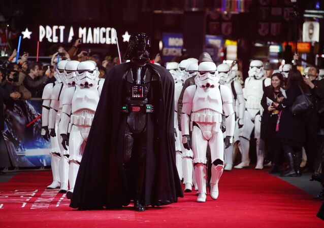 Actors dressed as Stormtroopers and Darth Vader arrive at the European premiere of the film 'Star Wars: The Force Awakens ' in London.