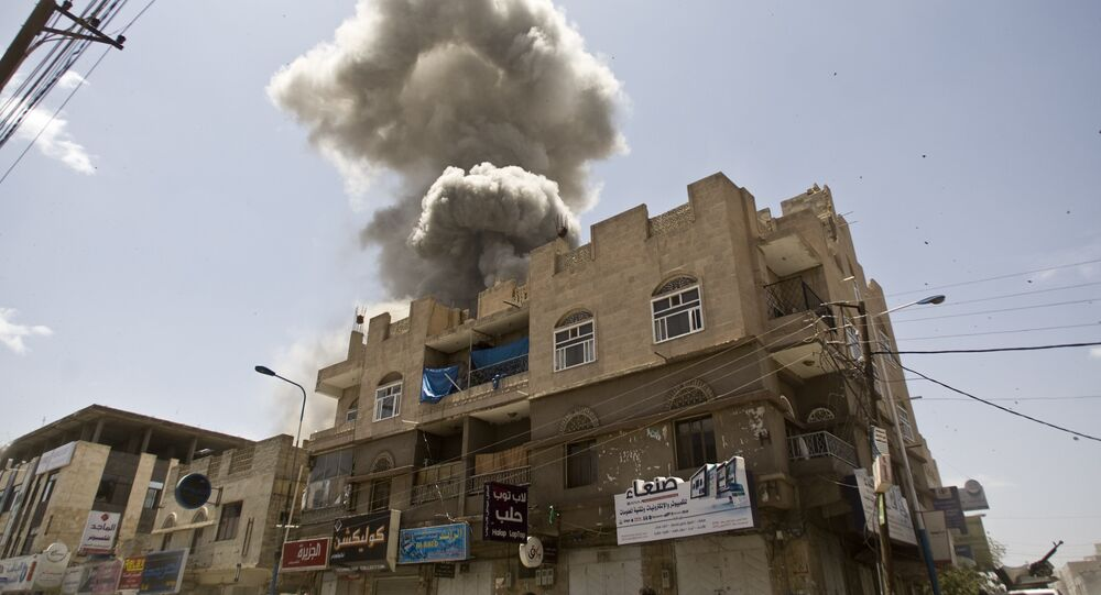 Smoke rises from a house of former Yemeni president Ali Abdullah Saleh after a Saudi-led airstrike in Sanaa, Yemen, Sunday, May 10, 2015.