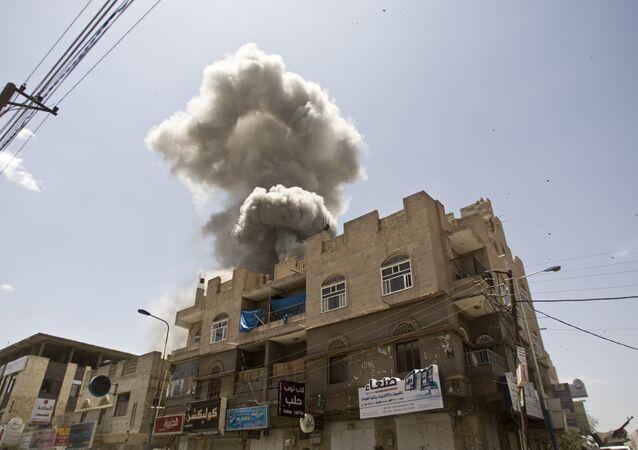 Smoke rises from a house of former Yemeni president Ali Abdullah Saleh after a Saudi-led airstrike in Sanaa, Yemen, Sunday, May 10, 2015.