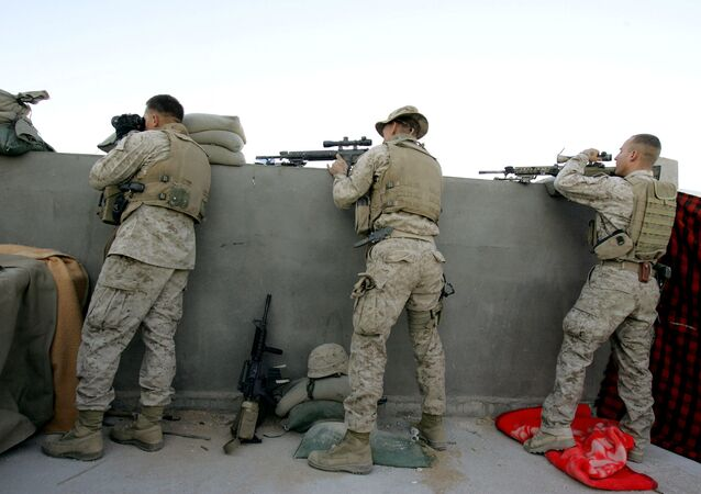 US marine sharpshooters with 3/6 Marines Recon Unit fire at insurgents and foreign fighters from a rooftopof a house the town of al-Qaim at the Iraqi-Syrian border (File)