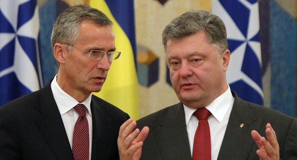NATO Secretary General Jens Stoltenberg, left, and Ukrainian President Petro Poroshenko talk before the meeting with he media in Kiev, Ukraine (file)