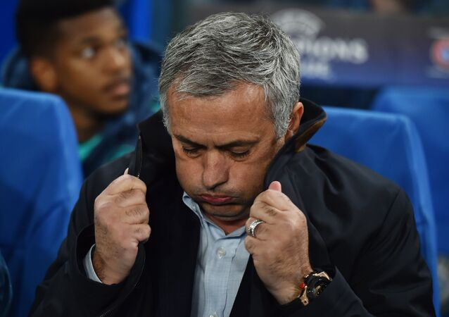 A picture taken on November 4, 2015 shows Jose Mourinho pulling up the collar on his coat during a UEFA Chamions league group stage football match between Chelsea and Dynamo Kiev at Stamford Bridge stadium in west London