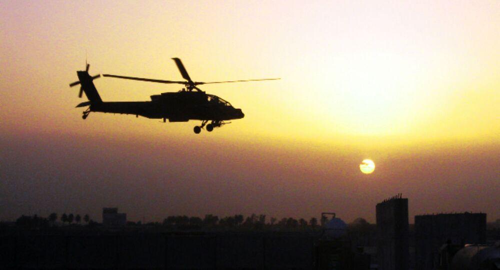 An AH-64D Apache helicopter, belonging to 1st Battalion, 4th Aviation Regiment, Attack Reconnaissance Battalion, flies over Iraq.