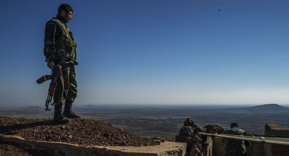 Soldiers of the Syrian Arab Army at an observation post at the frontline in the al-Kom village of the Quneitra province in Syria