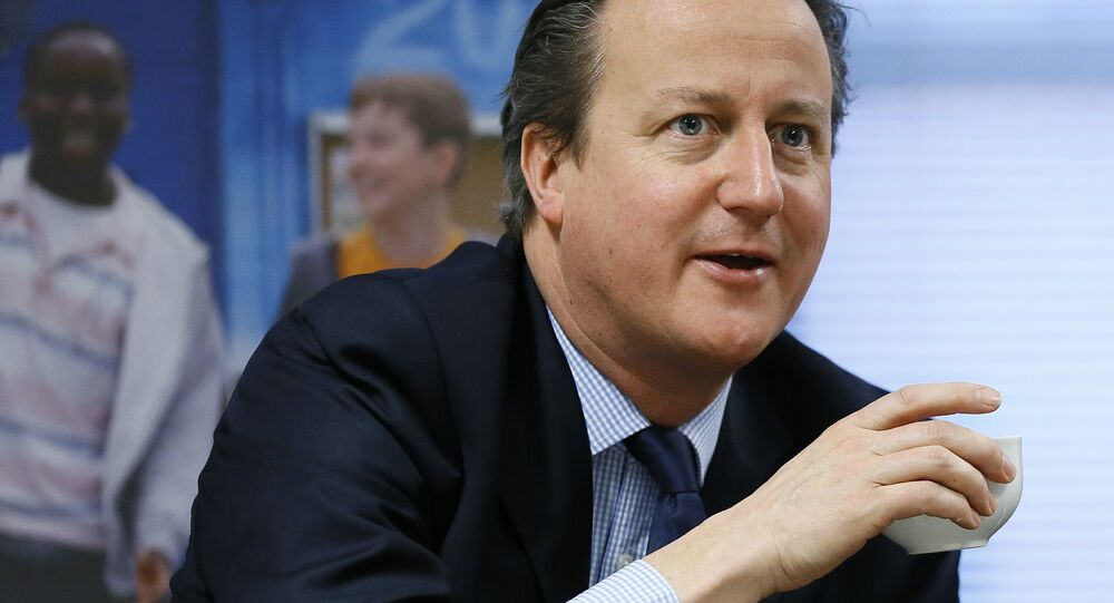 Britain's Prime Minister David Cameron takes a drink.