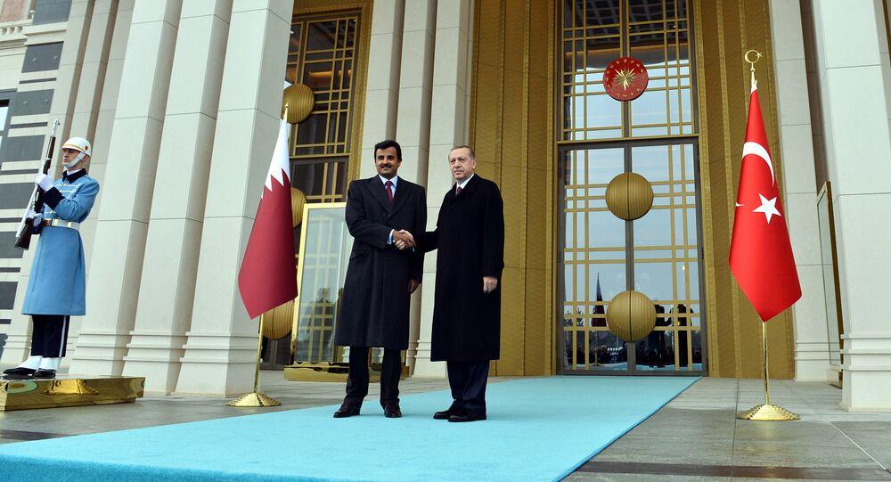 Turkish President Recep Tayyip Erdogan, right, and Qatar's Emir Sheikh Tamim bin Hamad Al-Thani shake hands at the entrance of new presidential palace in Ankara, Turkey, Friday, Dec. 19, 2014