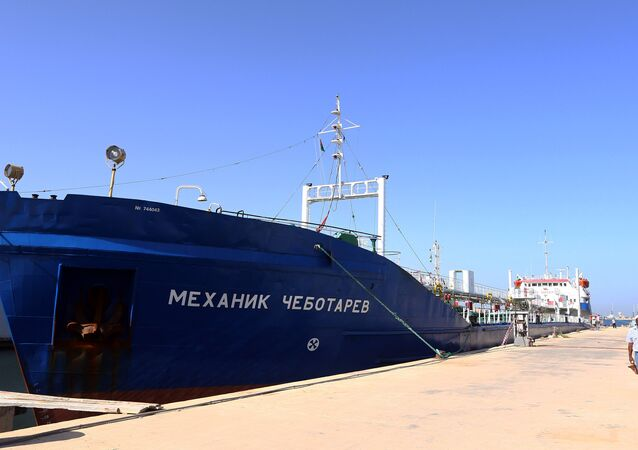A picture taken on September 17, 2015 shows a Russian flagged oil tanker after it was caught in Libyan waters without permission and brought to Tripoli's maritime base by Libyan coastal authorities for investigation as they believed the Russian crew were smuggling fuel from the port of Zuwarah, some 160 kilometres from the capital