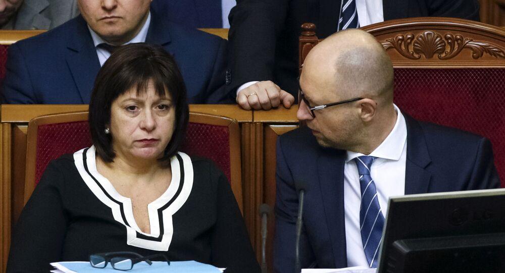 Ukraine's Prime Minister Arseny Yatseniuk (R) and Finance Minister Natalia Yaresko attend a session of parliament in Kiev, Ukraine, December 17, 2015