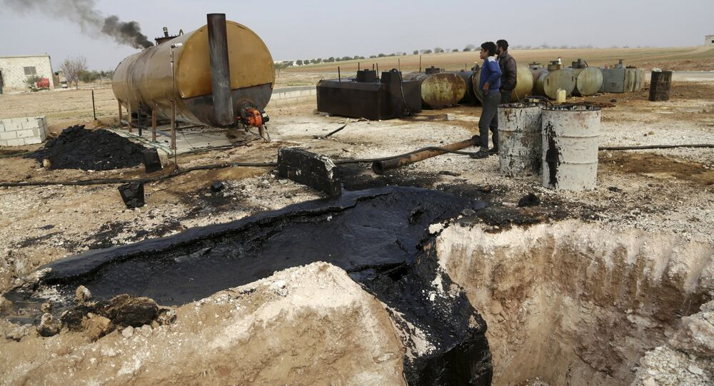 Men work at a makeshift oil refinery site in Marchmarin town, southern countryside of Idlib, Syria December 16, 2015