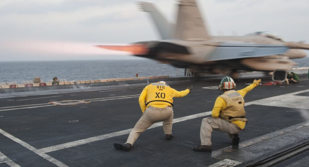 US Navy handout photo, flight deck crew launch an EA-18G Growler from the Nimitz-class aircraft carrier USS Carl Vinson (CVN 70) (File)