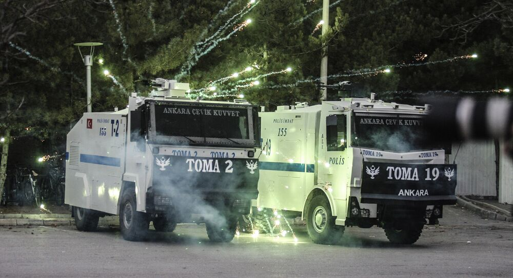Demonstrators throw fireworks at anti-riot police during clashes outside the Middle Eastern Technical University (METU) in Ankara on December 17, 2015