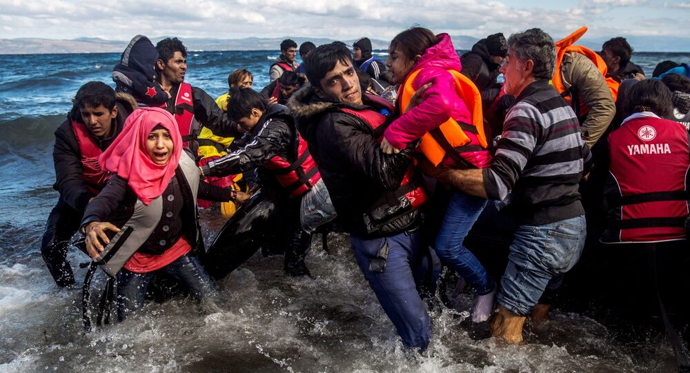 Migrants disembark safely from their frail boat in bad weather on the Greek island of Lesbos after crossing the Aegean see from Turkey, Wednesday, Oct. 28, 2015.