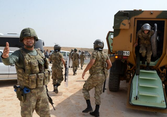 Turkish security forces block the road leading to Cizre, on September 9, 2015