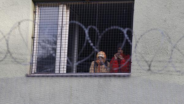 Migrants look out of a window at the Bela-Jezova refugee facility in Bela pod Bezdezem, Czech Republic, Thursday, Nov. 5, 2015 - Sputnik International