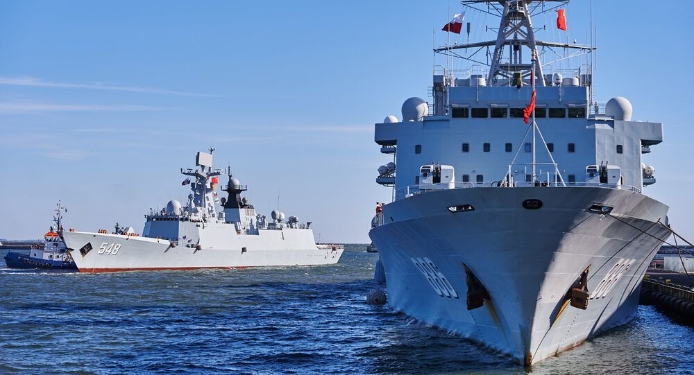 Chinese Navy replenishment ship 'Qiandaohu' (R) and multi-role frigate 'Yiyang' (L) enter the port of Gdynia in Gdynia, Poland, on October 7, 2015, marking the first-ever such visit in the NATO and EU member