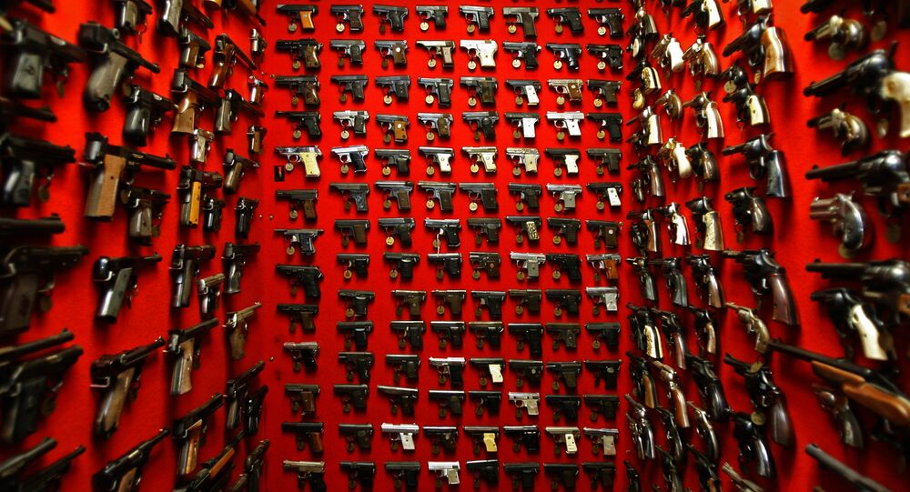 In this file photo, guns line the walls of the firearms reference collection at the Washington Metropolitan Police Department headquarters in Washington on Friday, Sept. 28, 2007
