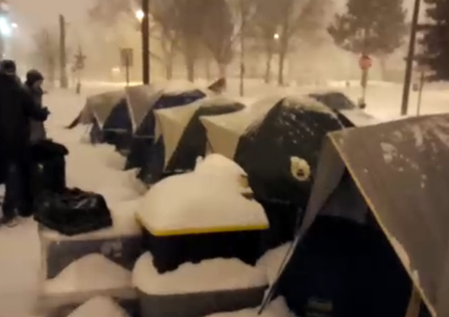 WATCH: Denver Police Raid Homeless Camp in the Middle of a Snowstorm